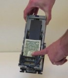 Removing a jammed bill or coin from a MEI series 2000 validator